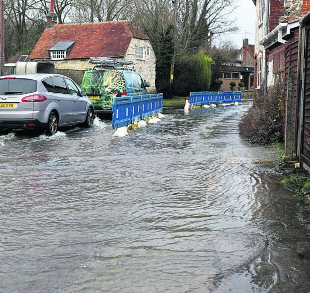 This Is Wiltshire: Flooding in Lottage Street, Aldbourne, this morning