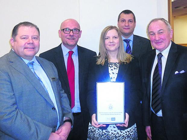 This Is Wiltshire: Phil Vanes from sponsor BM Polyco, DC Malcolm Gaskill, forensic scientist Claire Storey, DCI Sean Memory and retired DI Alan Webster at the awards ceremony