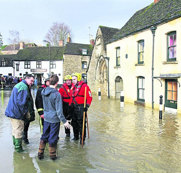 This Is Wiltshire: Malmesbury residents fear a repeat of scenes like this in 2012 when the town centre was flooded