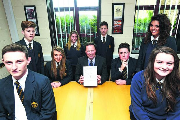 This Is Wiltshire: Lydiard Academy head teacher Clive Zimmerman with pupils