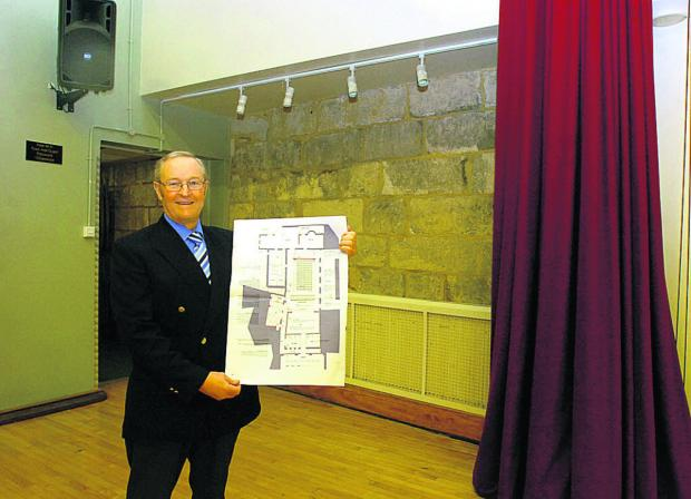 This Is Wiltshire: Coun David Powell, leader of Chippenham Town Council, with plans for the Neeld Hall