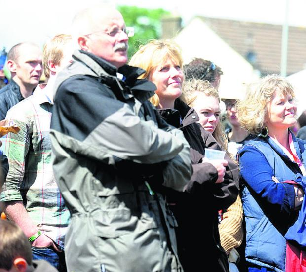 This Is Wiltshire: Onlookers enjoy the music at last year's SherstonFest
