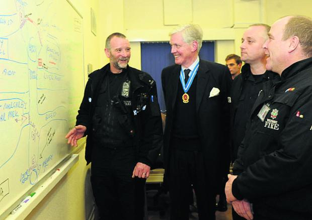 This Is Wiltshire: William Wyldbore-Smith, High Sheriff of Wiltshire, centre, meets members of the emergency services at Bradford on Avon fire station