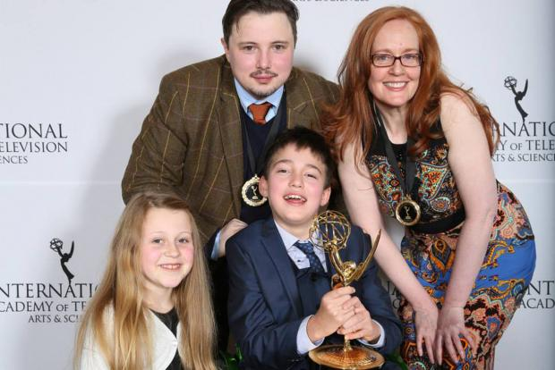 This Is Wiltshire: Phoebe Maddison, left, with David Barnes, Louise Lynch, Archie Cable and the Emmy award for factual winner