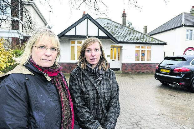 This Is Wiltshire: Pictured, left to right, are Anne Snelgrove (candidate for Swindon South) and Nadine Watts (Old Town ward councillor) outside the Marlborough Road Surgery which is due to close in March