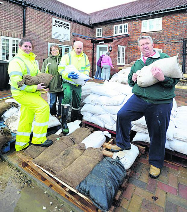 This Is Wiltshire: Sandbags provided by Wiltshire Council are being stored at the Community Junction youth centre. Shown are Rebecca Busby, of Wiltshire Council, Hazel Keen, youth council trustee, Martin Cook, of Wiltshire Council, and John Welch, of Lottage Road