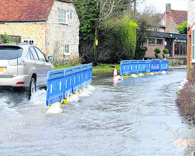 This Is Wiltshire: Flooding in Lottage Road, Aldbourne, this week