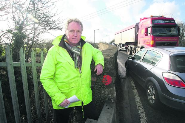 This Is Wiltshire: Brian Mathew at the railway bridges between Royal Wootton Bassett and Lyneham which are due to be closed for six months later this year