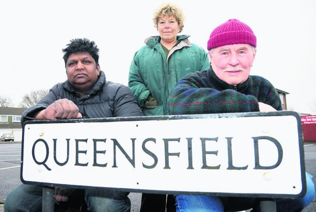 This Is Wiltshire: Jeyam Anthony, owner of Queensfield store, left, supported the lifting of the Queensfield traffic ban along with other residents, including Pat Jones and Reg Jones