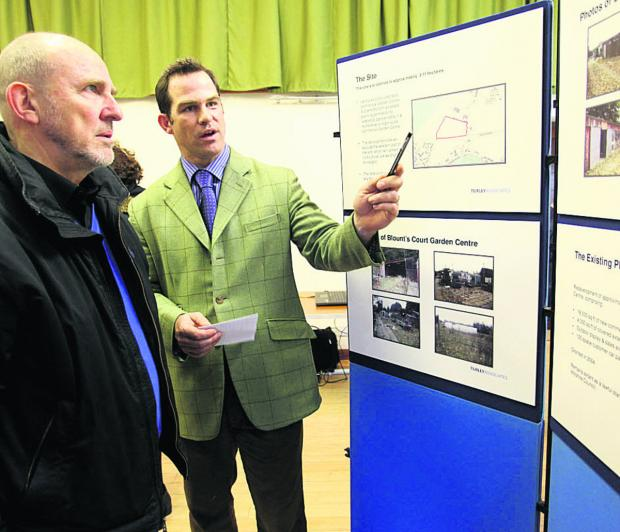 This Is Wiltshire: Bowood Estate manager Charles Leather, right, speaks to residents about plans for homes on a former nursery site at Studley