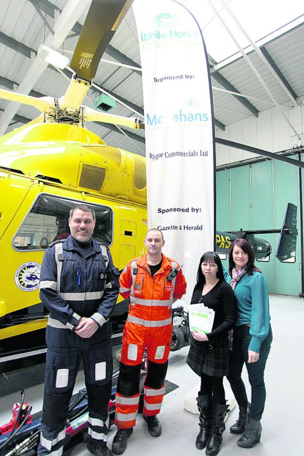 This Is Wiltshire: At the challenge launch are Nigel Gilbert of the police, paramedic Matt Baskerville, Zoe Meaden of Monahans and Claire Kelly of the air ambulance