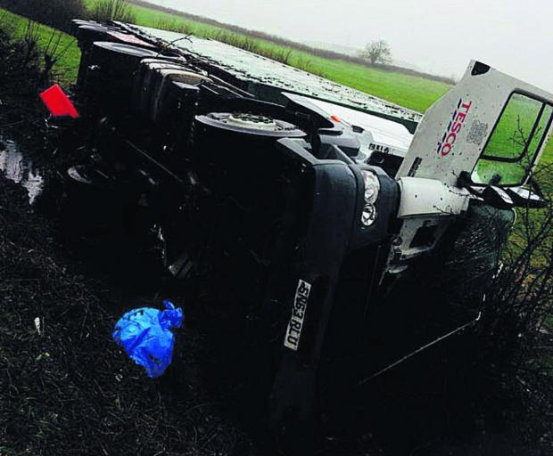 This Is Wiltshire: The lorry which toppled over on the B4042 Brinkworth Road today
