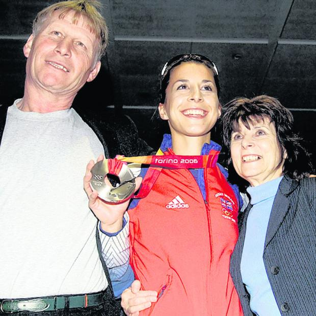 This Is Wiltshire: Jack and Josie Rudman pictured with daughter Shelley on her victorious return from the Turin Winter Olympics, where she won silver in 2006