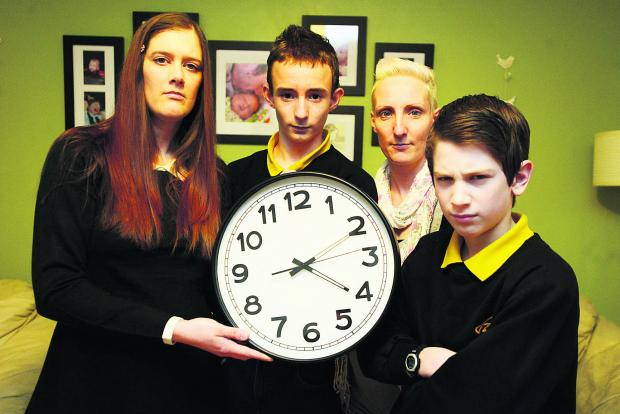 This Is Wiltshire: Parents are annoyed that break times at Isambard School have been cut by 15 minutes. Pictured are Amanda Wilkins, James, Wendy Smart and Angelos