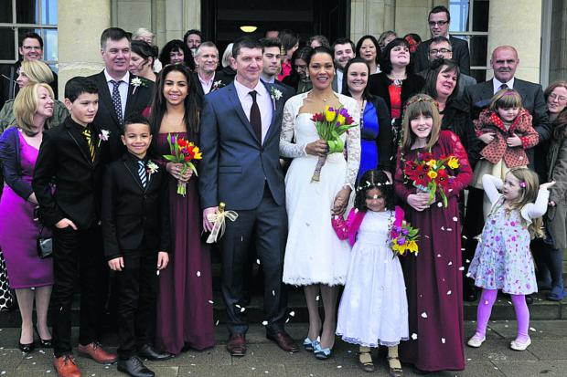 This Is Wiltshire: Berni and Jon Perry with their wedding guests at the new register office in County Hall