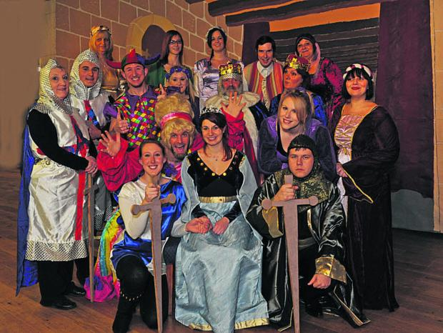 This Is Wiltshire: Panto princess Cristina Fernandez, seated, with Knight Laura Brixton, left, Black Knight Pip Knowles and the cast of the Melksham group's Knight Fever