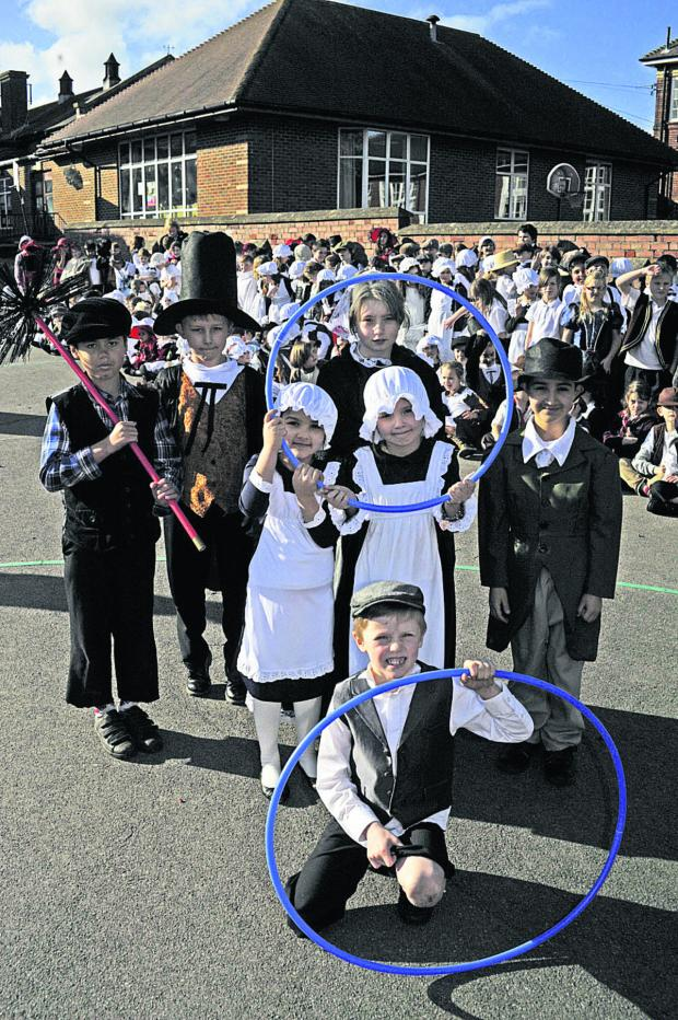 This Is Wiltshire: Pupils play in their period costume for a Victorian day
