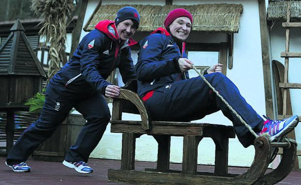 This Is Wiltshire: Paula Walker (right) and brakewoman Rebekah Wilson sit in a sledge during a photocall earlier this week, ahead of the women's two-man bobsleigh event, which starts on Tuesday