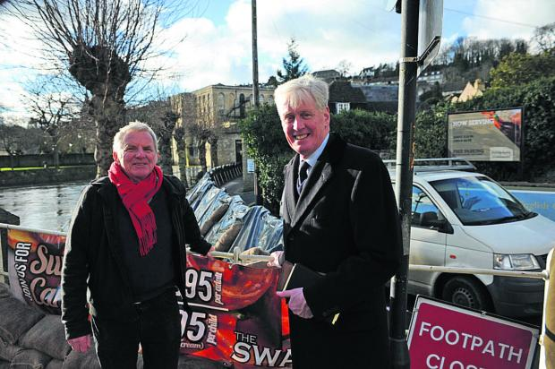 This Is Wiltshire: Mayor John Potter shows the town's flood defences to High Sheriff William Wyldbore-Smith