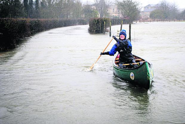 This Is Wiltshire: Jenny Sinclair paddles up the B3106 from Staverton to Holt