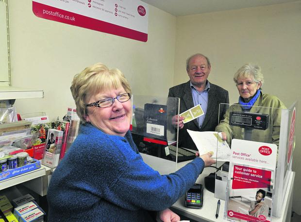 This Is Wiltshire: Ray and Rita Parsons serve customer Ann Hill at Westwood Post Office