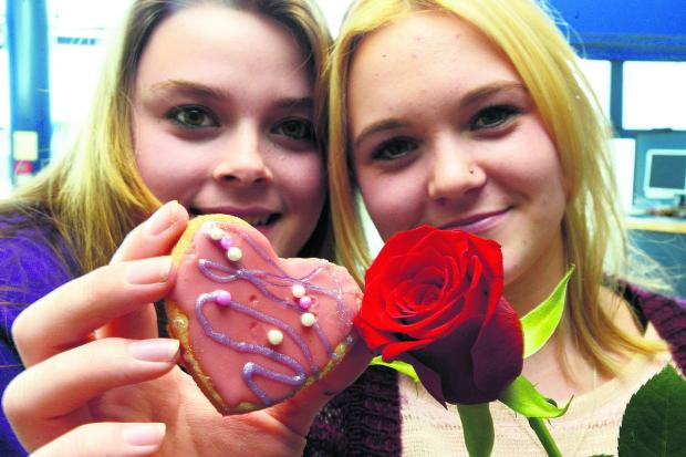 This Is Wiltshire: Valentine's cake sale by photography class at New College. Pictured Charli Loso and Jasmin Rennie