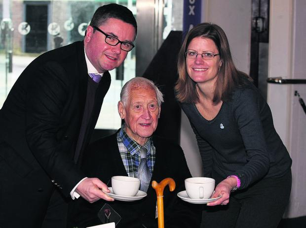 This Is Wiltshire: South Swindon Robert Buckland and Chris Atkinson, service manager at the Alzheimer's Society, offer Frank Richards a nice cuppa. Picture: STUART HARRISON