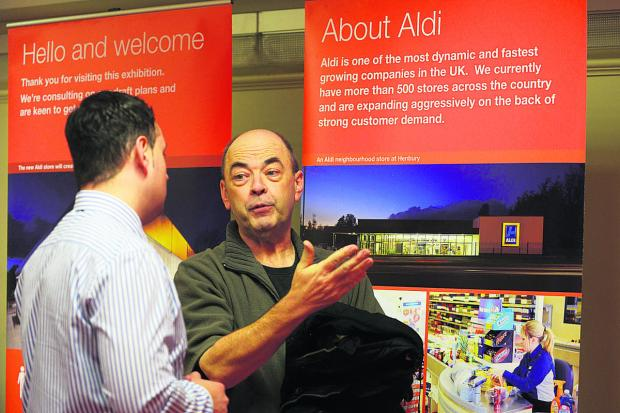 This Is Wiltshire: Shaw resident Kevin Hayes talks to Dave Adams of Entran Ltd about the plans for the new Aldi store. Picture: Thomas Kelsey