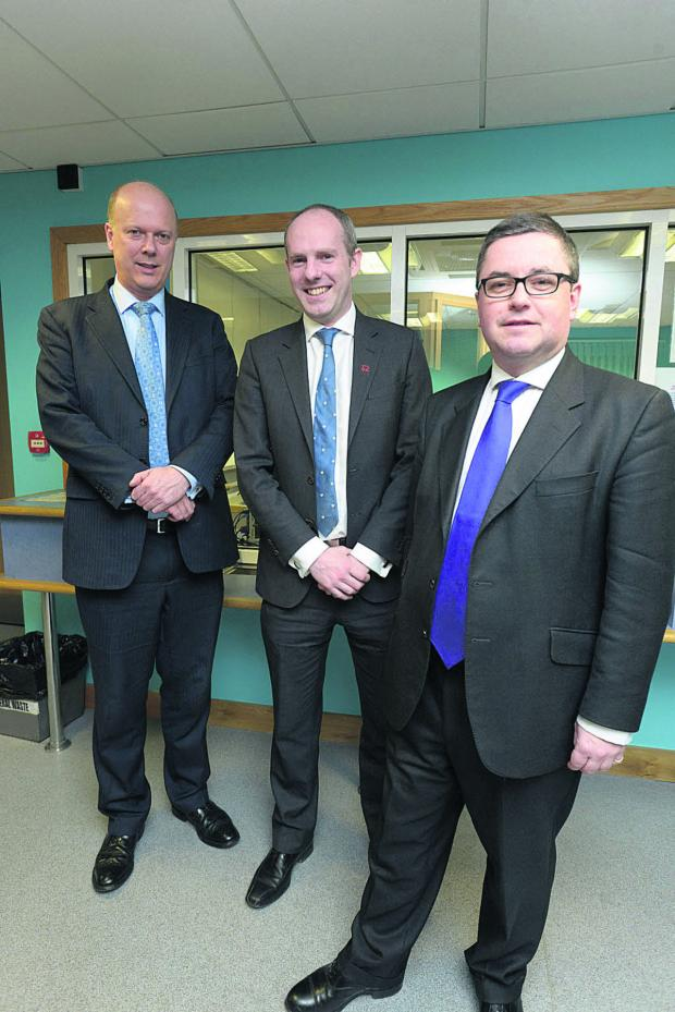 This Is Wiltshire: Chris Grayling at the probation offices in Swindon with Justin Tomlinson and Robert Buckland