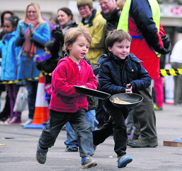This Is Wiltshire: Pancake races in Devizes Market Place attracts all ages