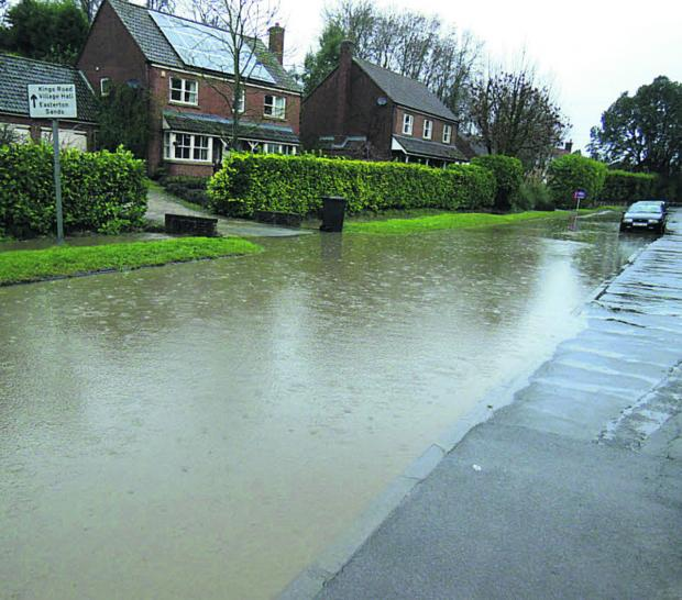 This Is Wiltshire: Water, water everywhere in Easterton High Street