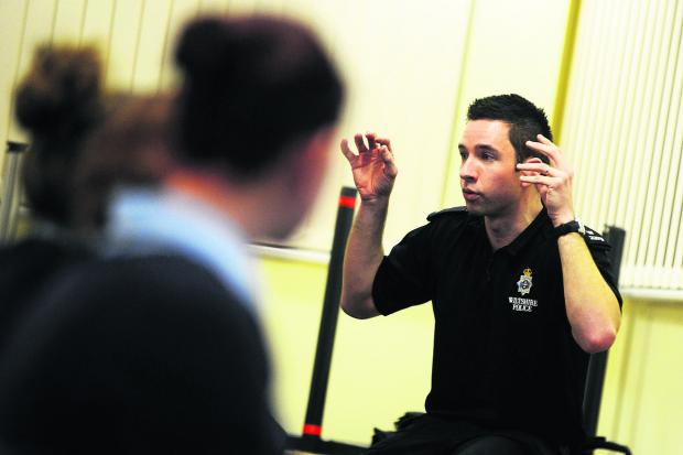 This Is Wiltshire: PC Dom Green talks to students at the police cadets training session