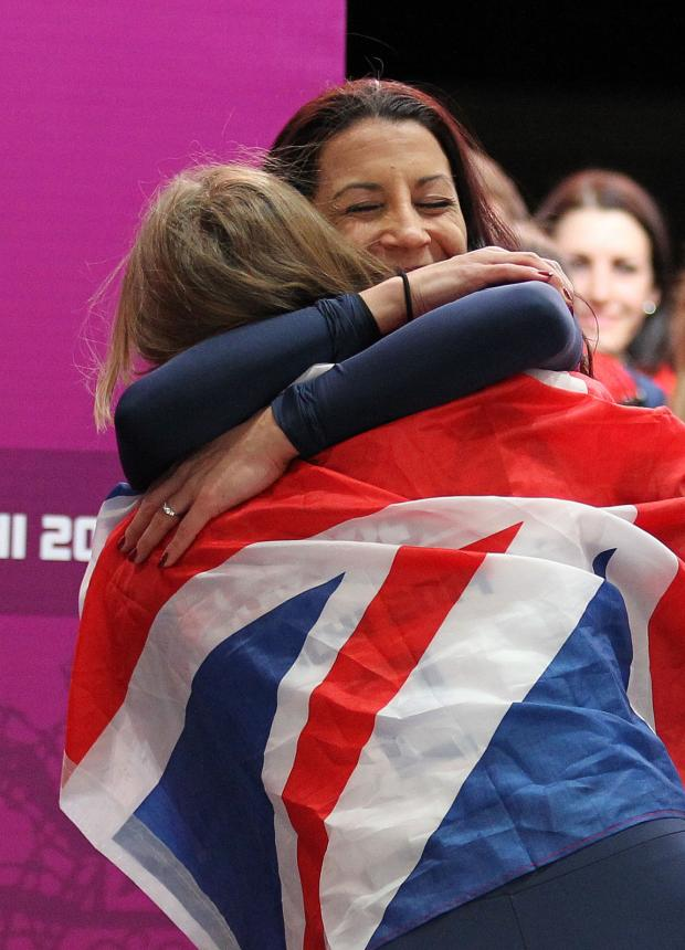 This Is Wiltshire: Shelley Rudman congratulates Olympic champion Lizzy Yarnold after today's skeleton finale