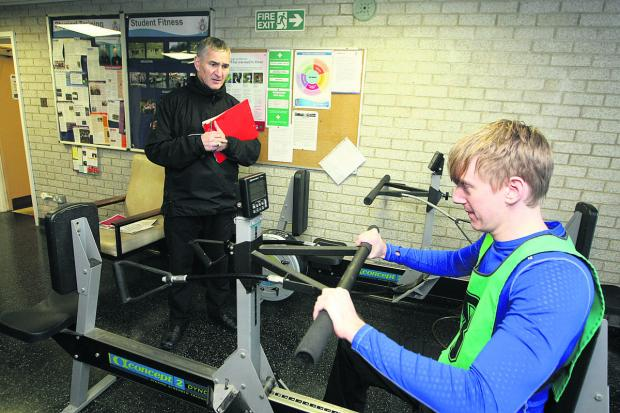 This Is Wiltshire: Lead physical training instructor Stuart Dinwoodie watches as Adver deputy news editor Scott D'Arcy has a go at the police fitness test