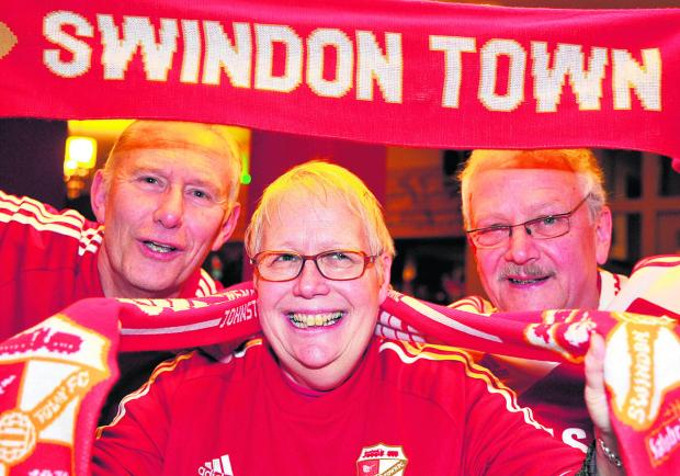 This Is Wiltshire: Town fans Shaun Moffatt, Ann Lovell and Pete Trudgian at the Merlin. Picture: DAVE COX