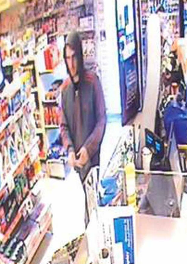 This Is Wiltshire: CCTV footage of the man police wish to speak to following the theft of £100 from a wallet