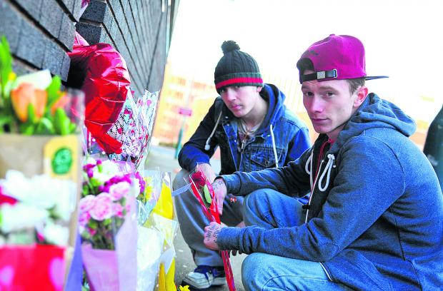 This Is Wiltshire: Aaron Devenney, left, and Damion Davies leave tributes to their friend Ashley McKinnon who died on Thursday night