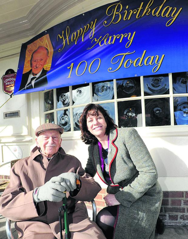 This Is Wiltshire: Harry Beckhough celebrates his 100th birthday at Marlborough Conservative Club with Devizes MP Claire Perry
