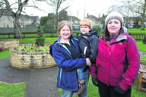 This Is Wiltshire: The Nature Of It's founding officer Camillia Merrett and son Ciaran with the organisation's founder Leanne Taylor in the garden area at John Coles Park