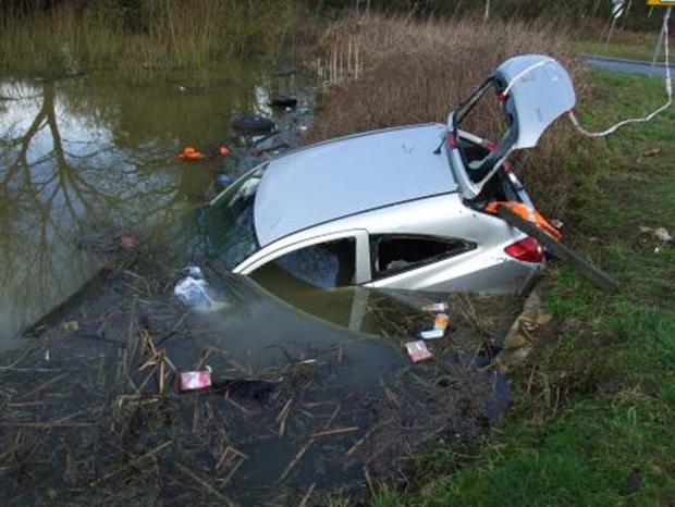 This Is Wiltshire: Two men had to escape Vauxhall Corsa after it plunged into pond