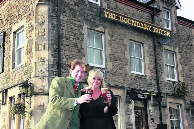 This Is Wiltshire: Carley Wilson, who has taken over the tenancy of The Boundary House toasts her position with George Arkell