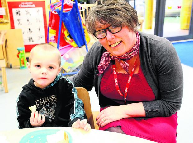 This Is Wiltshire: Springboard manager Jane Boulton with one of her young charges at the Chippenham nursery