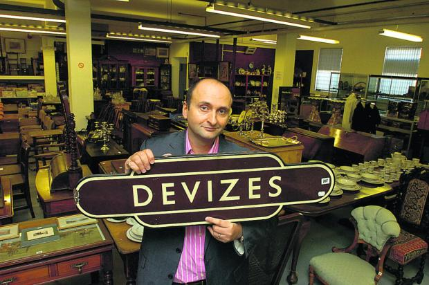 This Is Wiltshire: Andrew Aldridge with the Devizes station sign which sold at auction