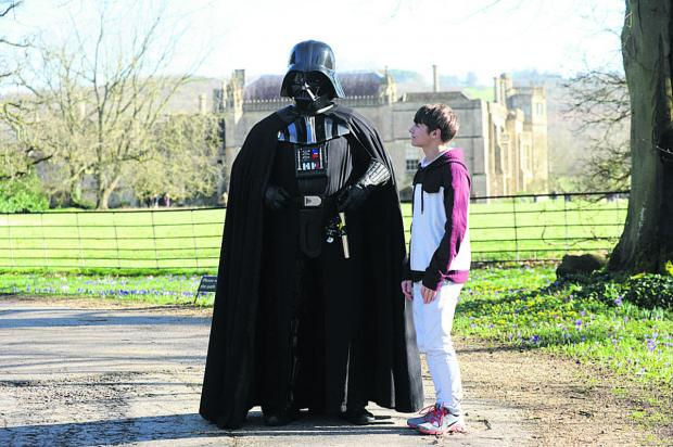 This Is Wiltshire: Reaze Enright takes a frighteningly close look at Darth Vader, from Star Wars, at the sci-fi event in the grounds of Lacock Abbey