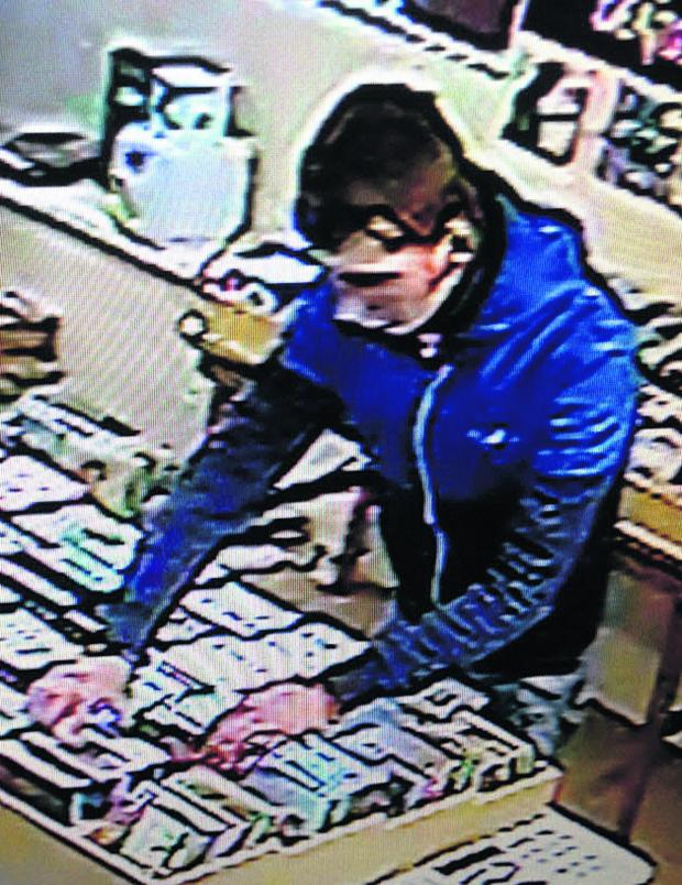 This Is Wiltshire: A CCTV image of one of the youths police would like to speak to after items were stolen from the Magpie shop in Chippenham