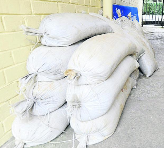 This Is Wiltshire: Malmesbury's voluntary flood wardens will know where to find sandbag supplies
