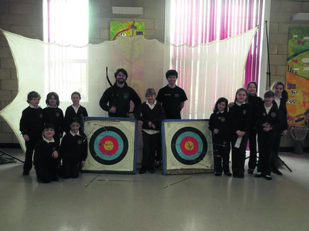 This Is Wiltshire: Children take part in archery sessions at Rushall Primary School