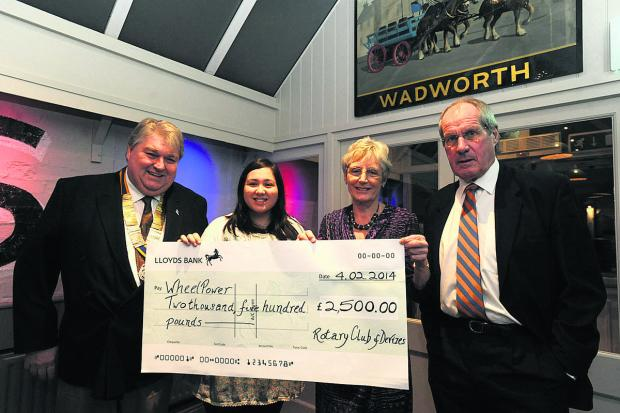 This Is Wiltshire: Devizes Rotary president Colin Lugg and WheelPower's Emma Lau with Jean Allen and Colin Clapshoe, right