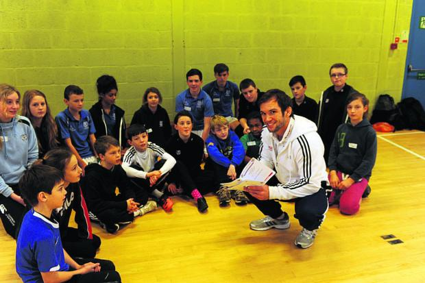 This Is Wiltshire: Helping put the legacy into action is Tom Reed, GB judo star, with some of the pupils