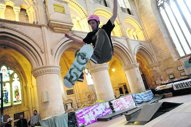 This Is Wiltshire: Chris Coombs flies through the air at Malmesbury Abbey